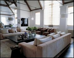 Kelly Hoppen Living room. Loft in London by @kellyhoppen. Contemporary design, luxury furniture, contemporary center table, exclusive design. For more design news: http://www.bocadolobo.com/en/news-and-events