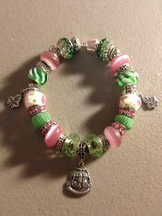 Sparkling Green & Pink AKA Greek Sorority SIGNATURE Charm Bracelet (w/Crest/Shield). $68.00, via Etsy.
