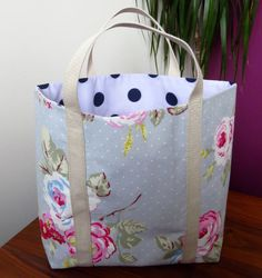 Handmade womens shopper or knitting bag. The straps are sturdy and easy to hold.