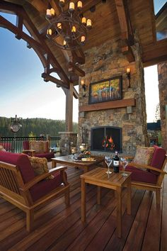 Detailed woodwork on the patio cover, the stone work, outdoor art, and chandelier make with patio uniquely special.