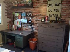 """My sons Skateboard boys bedroom. Wall """"bricks"""" are a eight piece wallpaper mural purchased from Sears. Extra sections cut to add """"broken"""" brick to corners of room."""