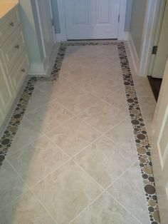 18x18 Cascade tile with a Bubble series border to give a walkway between rooms a little extra kick.