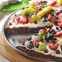Brownie Fruit Pizza - A perfect project at your child's next sleepover or birthday party, this brownie pizza topped with fruit will be a hit with the kids. Bake the brownie mix and semi-sweet chocolate morsels in a pizza pan ahead of time and then let the kids decorate with whipped topping and pizza-inspired fruit decorations, like pineapple chunks, strawberry slices and kiwi.