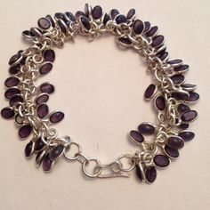 💯% 925 Sterling Silver 💜 Amethyst charm bracelet Price DROP..Firm. Awesome 💯% Sterling silver 925, multi bezel,💯% purple amethyst gem stone adorned, charm bracelet. Hook style closure.  NWOT, adjusts from 8- 8.5 inches in length, with a width measuring a little over 1 inch when fully spread. Very beautiful, handmade/crafted work of art.💜🎀💞 Made by artistic hands Jewelry Bracelets