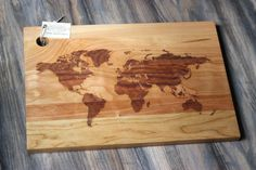 AWESOME stuff. This guy does custom boards as well as specific states.   World Map Cutting Board - Rustic, Modern Reclaimed Wooden Design