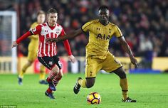 Tottenham midfield powerhouse Victor Wanyama looks to play the ball as Southampton's Davis trails behind the Kenyan