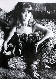 Helen Mirren among the cushions of her living-room sofa, wearing Albini's  print crepe de chine pantaloon suit,   photo by Snowdon, 1976