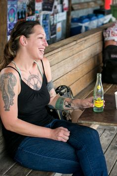 Maggie Rounsavall sips a Topo Chico at Jo's Coffee in Austin, Tex. (Photo: Ilana Panich-Linsman for The New York Times)
