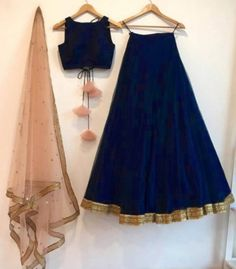 Navy blue silk lehenga choli set with a contrast embroidered peach dupatta. The lehenga choli is a c Lehenga Skirt, Lehnga Dress, Silk Lehenga, Black Lehenga, Navy Blue Lehenga, Ghagra Choli, Trendy Dresses, Fashion Dresses, Jugend Mode Outfits