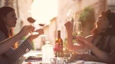 Friends raising wine glasses to make a toast and drinking wine, Slow motion - HD stock video clip