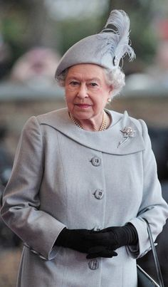 Queen Elizabeth wearing a grey toque embellished with a jaunty feather | The Royal Hats Blog
