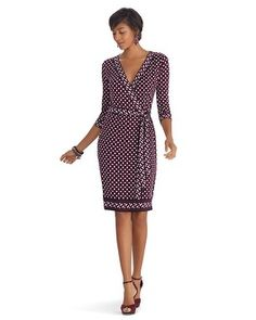 Slinky stretch knit dress in alluring geometric print with pops of purple. Wrapped style with attached self-belt and 3/4 sleeves for an easy fit and comfortable wear.