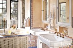 Romantic Guest Bath Designed by Alissa Sutton this guest bathroom in the Greystone Mansion features a pair of pedestal sinks and colorful ti...