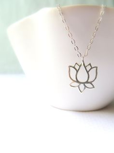 Lotus flowers, associated with purity and beauty, are perfect for brides or bridesmaids! so pretty!