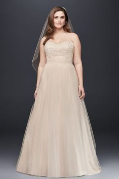 Ethereal elegance meets modern day fairy tale in this enchanting strapless tulle wedding dress!  Strapless A line gown features stunning beaded lace detail on bodice.  Soft tulle skirt adds movement and is absolutely breath-taking.  Sweep train.    Fully lined. Back zip. Imported polyester. Dry clean.  Also available in Missy ,  Extra Length , and Plus Size Extra Length   To preserve your wedding dreams, try our Wedding Gown Preservation Kit