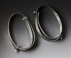 Double rivet loop earrings by LisaColbyMetalsmith on Etsy