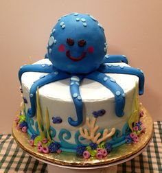 Octopus baby shower cake inspired by Tea Party Cakes original design.