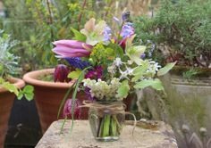 Lock Cottage Flowers: homegrown spring woodland arrangement with magnolia, fritillaria, epimedium, primula, pieres, scilla, hellebore and others