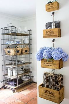 A baker's rack was added to an empty kitchen nook to maximize kitchen storage and display favorite serving pieces