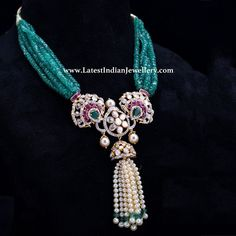 Classic regal jewellery in a fine combination of emerald beaded strings with polki and diamond studded center pendant embellished with pearl tassel drops. Cz Jewellery, Jewelry Design Earrings, Coral Jewelry, Gold Jewellery Design, Beaded Jewelry, Pearl And Diamond Necklace, Emerald Necklace, Indian Necklace, Indian Jewelry