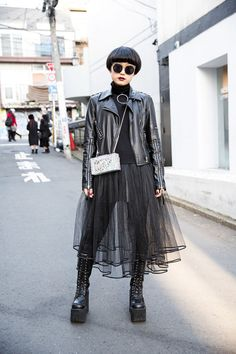 14-year-old Moeka on the street in Harajuku wearing a Glad News biker jacket with a tulle skirt, Yosuke platform boots, and a cute lilLilly bag.