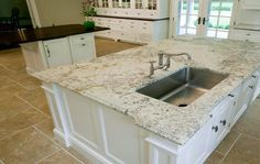 Bianco Romano Granite Island, black counters in rest of kitchen