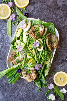 Simple grilled spring greens with homemade lemon parsley butter make the perfect side dish as we start to welcome some sunshine to the year!