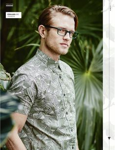 Embrace this season's jungle fever with green specs and a graphical print shirt.