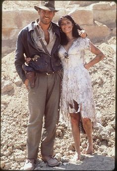 Harrison Ford and Karen Allen pose for the camera on the set of Raiders of the Lost Ark,1981.