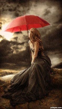 Le mie lacrime si confondono con le goccie di pioggia.......il mio cuore è colmo di tristezza.....