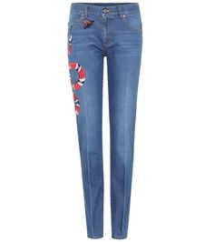 Gucci - Appliquéd slim jeans - Gucci opts for a reliably flattering fit with this pair of mid-rise, slim-fit blue jeans. Crafted from pure cotton, this pair will get softer over time while retaining its form. The brand's iconic motif, the red coral snake, can be seen coiling its way across the leg, flanked by embroidered appliqué bee and daffodils. Pair yours with one of the designer's iconic blazers for a retro feel. seen @ www.mytheresa.com