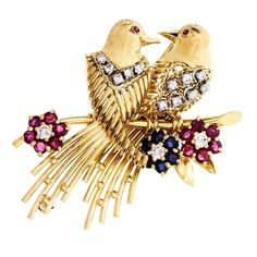 Diamond Ruby Sapphire Gold Love Birds Brooch. 18k yellow Gold 15 round Diamonds, approx. total weight .38cts, G, VS 6 round fine blue Sapphires, approx. total weight .50cts, SI1 14 round fine red Rubies, approx. total weight 1.00cts, SI1 Top to bottom: 50.37mm or 1.98 inches. Width: 34.66mm or 1.36 inches. Depth: 7.95mm. 20.5 grams. Tested and stamped: 18k. Hallmark: AE56.