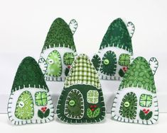 Set of three little hanging houses, handmade with felt and vintage cottons in green and white. The roofs, doors and windows are hand- appliqued with vintage cot