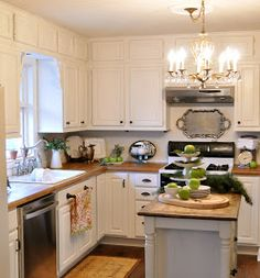 Budget Kitchen Remodel - excellent post with lots of info on how this budget- and eco-friendly kitchen was remodeled. By reusing what they had and by researching materials, these homeowners were able to get the kitchen they wanted while staying on a budget.