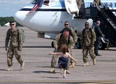 Three year-old Kaylee runs to her Daddy, Sgt. Michael Aros-Truhe, upon his return from Afghanistan.