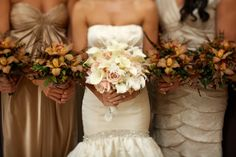 I don't like how the bridesmaids dresses are different but I like how the flowers are different, pretty!