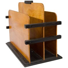 Art Deco Wooden Magazine Rack with Black Accents | From a unique collection of antique and modern magazine racks and stands at https://www.1stdibs.com/furniture/more-furniture-collectibles/magazine-racks-stands/