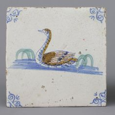 A Dutch Delft polychrome tile with a swan, 17th C. : Lot 433