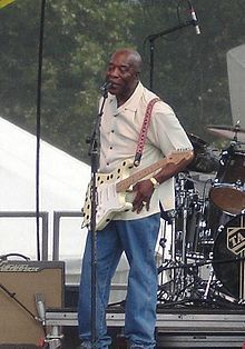 Well-known Chicago blues players include singer/songwriters such as Muddy Waters, Howlin' Wolf, Willie Dixon, and Koko Taylor; guitar players such as Freddie King, Otis Rush, Luther Allison, Magic Sam, Syl Johnson, Jimmy Rogers, Buddy Guy, Robert Lockwood Jr., McKinley Mitchell, Bo Diddley, Mike Bloomfield and Elmore James; harmonica players such as Big Walter Horton, Little Walter, Charlie Musselwhite, Paul Butterfield, Junior Wells and Jimmy Reed; and keyboardists such as Marty Sammon.