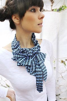 Ruffled scarves made from old ties ~ look absolutely stunning! From Boston based designed Lilian Asterfield.  PS: also love this woman's hair :)