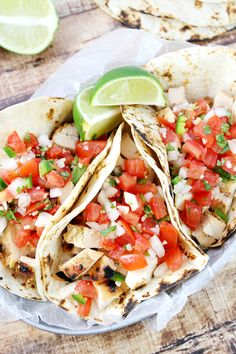 citrus marinated Grilled Chicken Fresco Tacos Served with a spoonful of Pico de Gallo