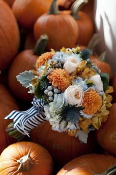 fall boquet -- orange dahlias, peach garden roses, silver brunia berries, dusty miller etc.