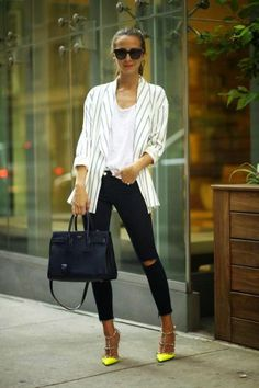 oversized white pinstripe blazer worn over a white t-shirt, ripped skinny jeans + neon yellow studded heels