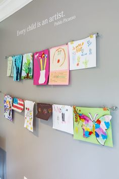 A Fun and Easy Way to Display Kids' Artwork at Home. how to display kids artwork at home Is your fridge overloaded with masterpieces from the kiddos? This simple and super functional DIY project is a great way to display kids' artwork at home. Colorful Playroom, Modern Playroom, Playroom Art, Playroom Storage, Playroom Design, Small Playroom, Playroom Colors, Playroom Layout, Toddler Artwork