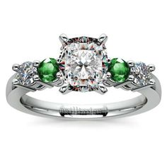 Who doesn't love the shimmering freshness of gorgeous green emeralds alongside sparkling diamonds? 2013's colour of  the year enhances this piece's Cushion-cut center diamond: Discover the Round Diamond and Emerald Gemstone Engagement Ring in sleek Platinum! http://www.brilliance.com/engagement-rings/round-diamond-emerald-gemstone-ring-platinum