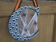 All eyes on you! Cover a plain monogram letter with googly eyes for a  personalized spooky Halloween decoration