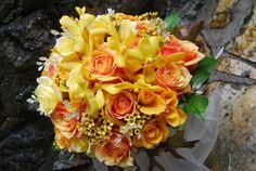 yellow roses, mokara orchids, wax flower