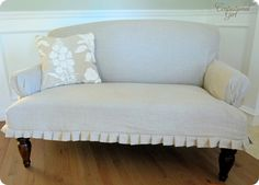 Add a DIY slipcover using a dropcloth to brighten up your upholstered pieces.    #springintothedream