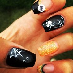 These spider-inspired nails are the perfect nail art designs for Halloween.