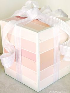 Skip the wrapping paper and, instead, cover your present one side at a time with colorful paint chips. #crafts #diy